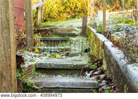 Ice And Frost On Frozen Garden Steps On A Path In Winter