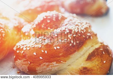 Fresh Twisted Buns With Sesame Seeds In The Early Morning. Morning Sunshine