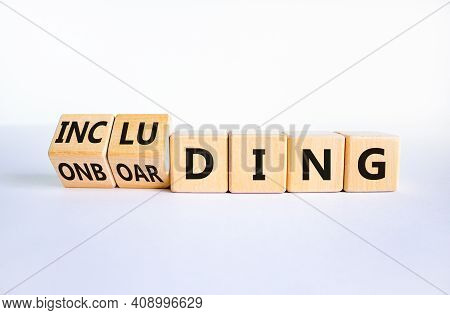 Onboarding And Including Symbol. Turned Wooden Cubes And Changed The Word 'onboarding' To 'including