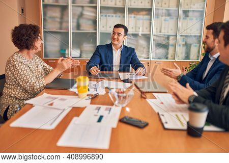 Business lawyers workers meeting at law firm office. Professional executive partners working on finance strategry at the workplace. Clapping to each other for successful achievement.