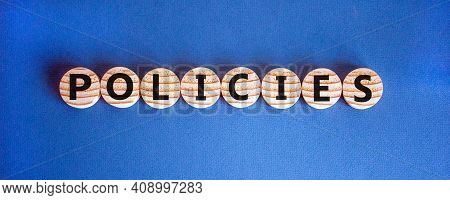Policies Symbol. Concept Word 'policies' On Wooden Circles On A Beautiful Blue Background. Copy Spac