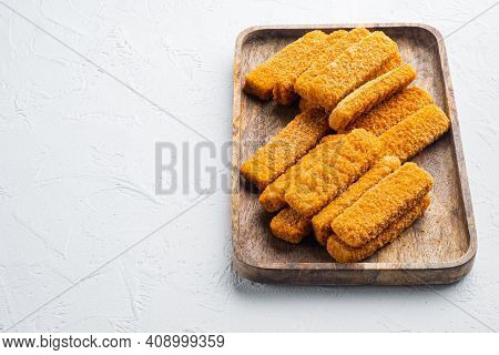 Frozen Fish Breadcrumbs Set, On Wooden Tray, On White Background , With Copyspace  And Space For Tex