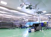 The image of modern operation room filled with equipments poster