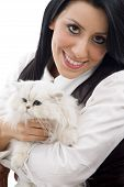 young model posing with her kitten against white background poster