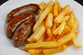 Close up of Sausage and chips. A traditional British Dish poster