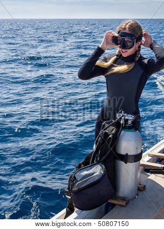 Caucasian Woman on Boat in Preparation for Scuba Diving