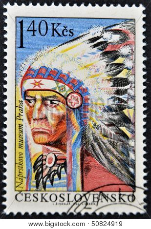 A stamp shows a picture of native American Indian chieftain with feather headband