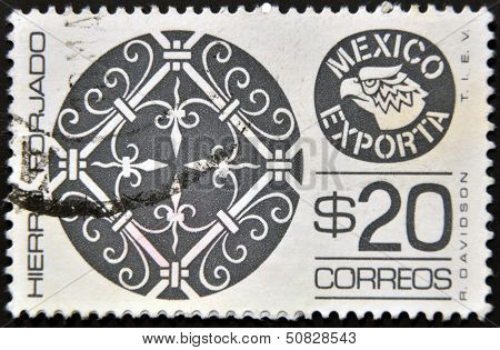 A stamp printed in Mexico shows filigree ironwork with the words Hierro Forjado