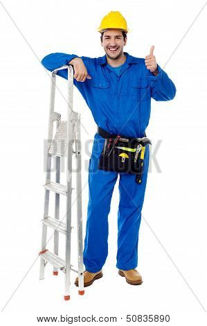 Plumber Posing Confidently With Thumbs Up