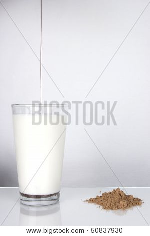 Syrup Pours Into Glass Of Milk