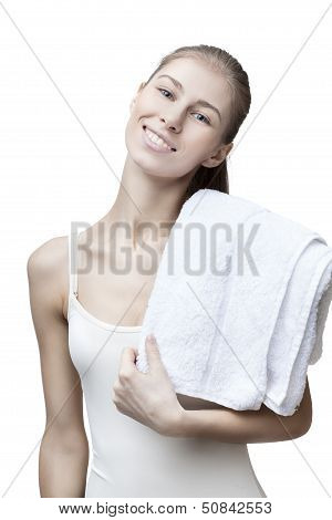 young blond woman with bathtowel isolated on white