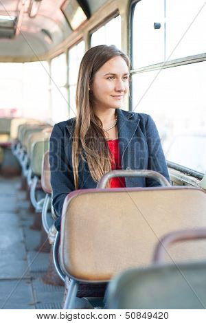Beautiful Young Woman Sitting In Vintage Bus