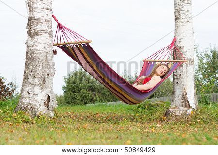 Beautiful Young Woman Sleaping In Colorful Hammock