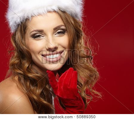 Portrait of beautiful sexy girl wearing santa claus clothes  poster