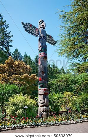 Totem Pole stands in the Butchart Gardens, Central Saanich, British-Columbia, Canada