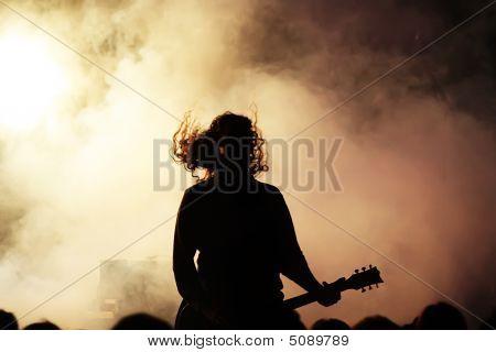 Guitar Player In actie op het podium