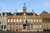 Beautiful town hall of Roermond Limburg Netherlands. The top features dancing figures and bells. poster