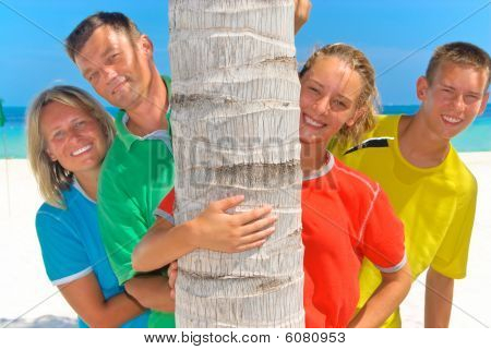 Family behind palm tree