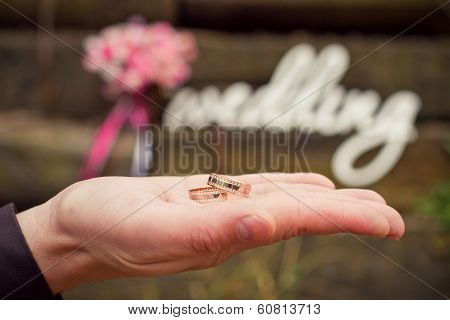 Word Wedding, Bouquet And Groom's Hand With Rings