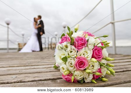 Bride And Groom Together On The Bridge