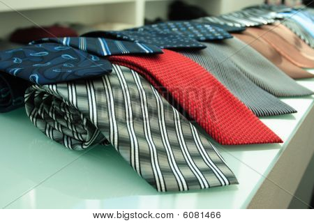 Red Gray Blue And Others  Necktie  On Shelf
