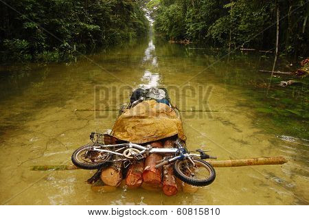 Folding Bycicle At Raft Flooded Gravel Road