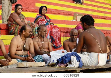 Brahmins (priests) perform puja - ritual ceremony at holy ghats,Varanasi,India