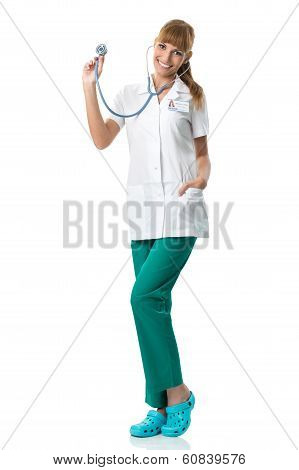 Smiling Doctor in white medical gown showing stetoscope