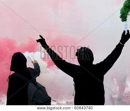 Two Protesters After A Soccer Match With The Smoke