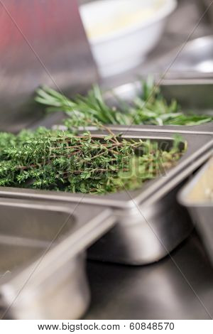 Fresh Rosemary Sprigs On A Kitchen Counter