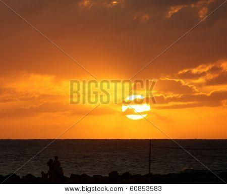 A Golden Caribbean Sunset Taken From The Beach Overlooking The Ocean