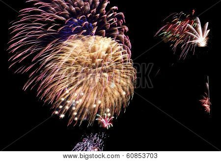 A Still Image Freezing The Effects Of Fireworks In The Summer Time