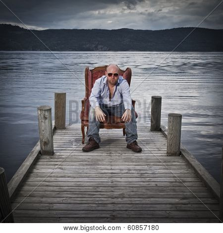 Man in Chair on a Pier