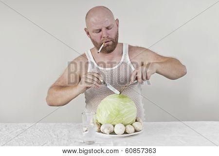 Smoking man eat cabbage and mushrooms
