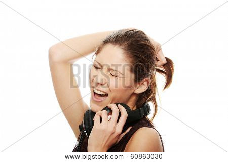 Young caucasian woman with headphones on her nack