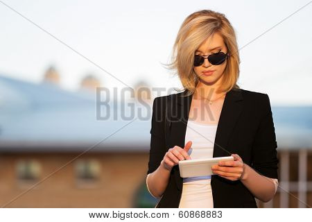 Young business woman using a digital tablet computer