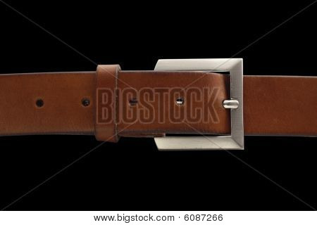 Brown belt with buckle isolated on black