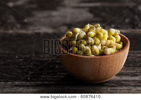 Green Peas Sprouts In A Wooden Bowl