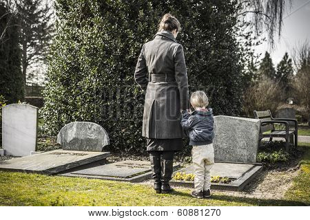 Woman and child at graveyard