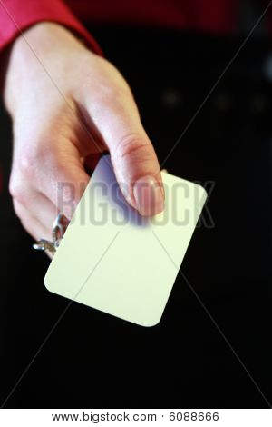 A hand with a business card
