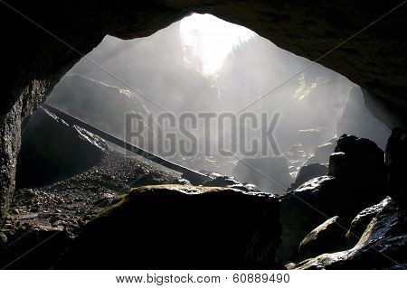 A foggy dark cave entrance silhouette in Padis Romania poster