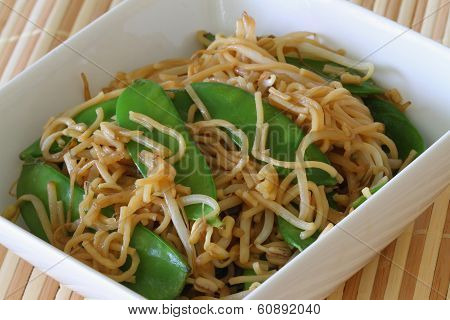Bowl of egg noodles stir fried with snow peas and beansprouts