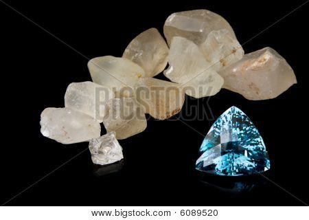 Trilliant Cut Blue Topaz And Rough Stones