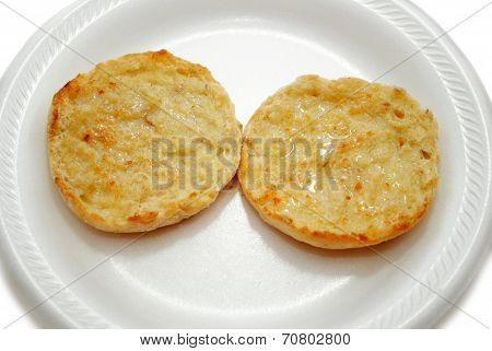 Two Eglish Muffin Halves Served on a Plate poster