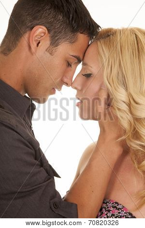 Couple Foreheads Touch Close Serious