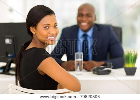 attractive african office worker looking back