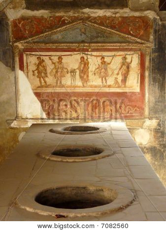 Ancient painted wall fresco at Pompeii, Italy