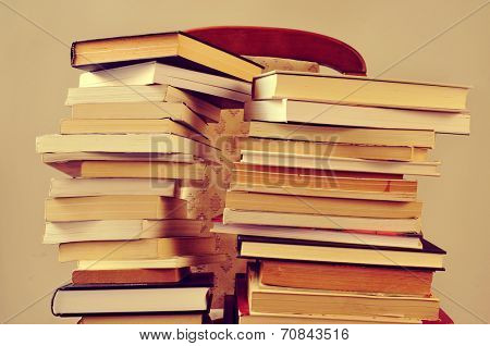 closeup of some piles of books on a chair, with a retro effect