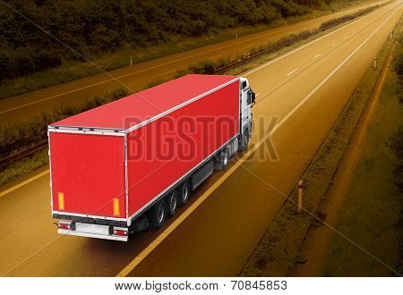 Red truck on the highway. Picture with space for your text.