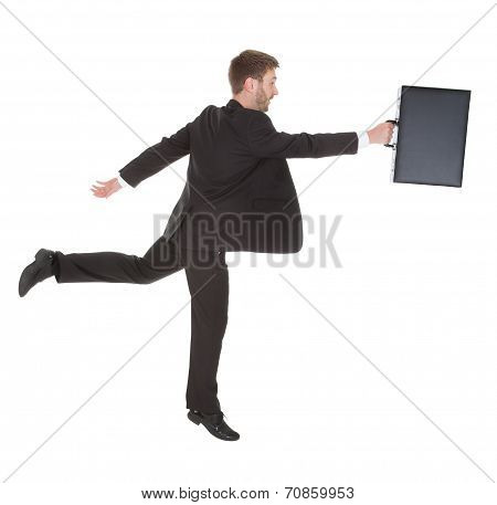 Businessman With Suitcase Running Over White Background